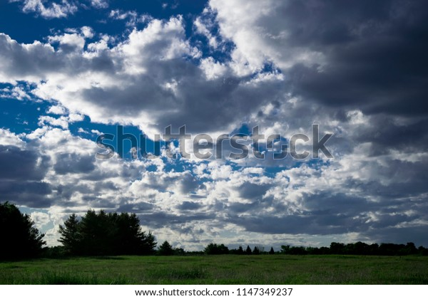 Field with dark contrast clouds