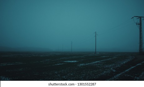 field at dawn / haze with power lines