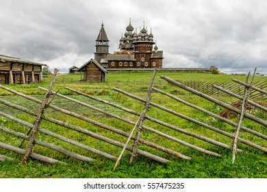Field fence in front of Kizhi Churchyard and behind Oshevnev peasant historical house, UNESCO world heritage site, Karelia, Russian north-west