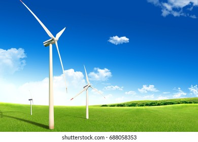 Field of grass, windmill and blue sky
