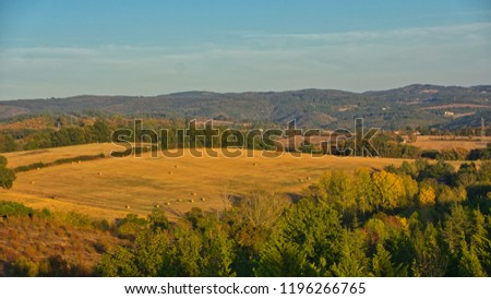 A field with hay bails on a dry hillside near Castres, Southern France