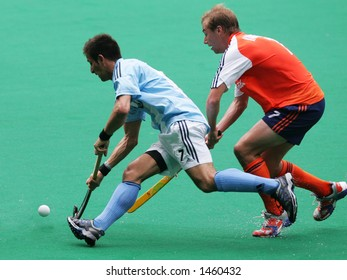Field hockey match Agentina vs Netherland (orange)