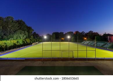 Field hockey stadium sports arena with lights at night