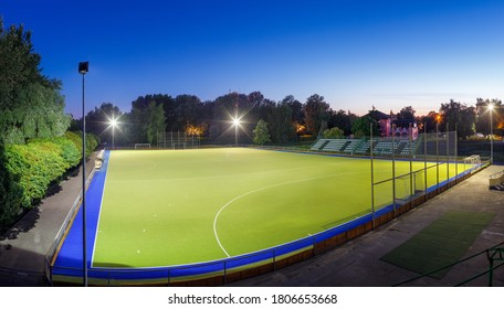 Field hockey stadium sports arena with lights at night
