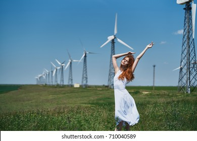 field of mills, woman in white dress, nature, silence, sunny day