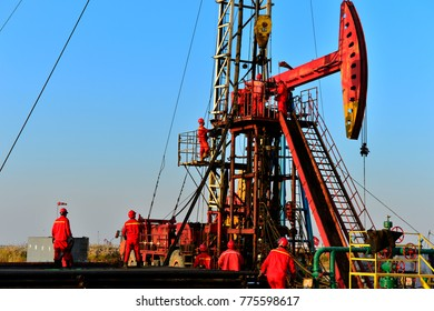 field oil workers at work