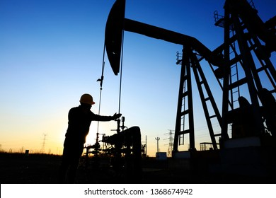 In the evening,oil field, the oil workers are working