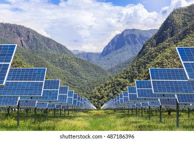 field of photovoltaics in solar power station with mountains background