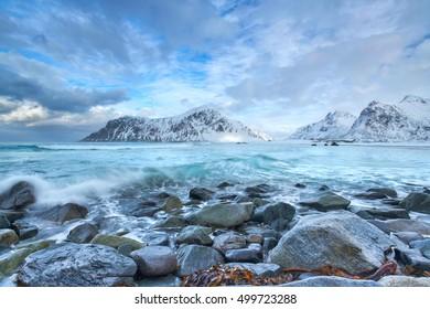Field of rocks on Unstad beach, Vestvagoy island, Lofoten islands, Norway, Long time exposure