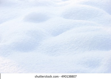 Field of shiny white snow. Real snow surface for backgrounds. Shallow depth of field