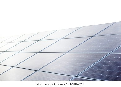 field of solar panels close up at sun set time.