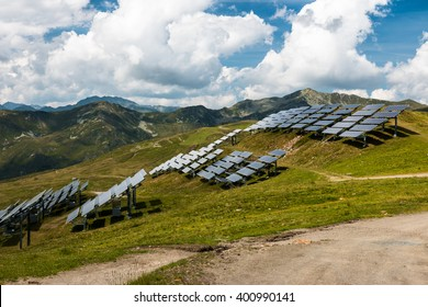 field of solar power panels in the mountain resort in austrian alps as renewable energy source