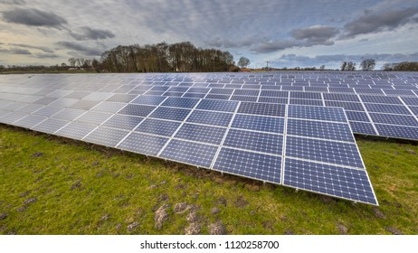 Field of Solar power panels ,Photovoltaic modules for innovation green energy for life with blue clouded sky background.