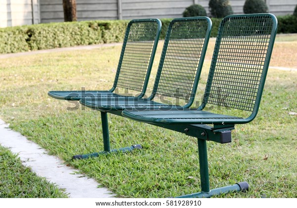 Field steel chair with green color on a garden
