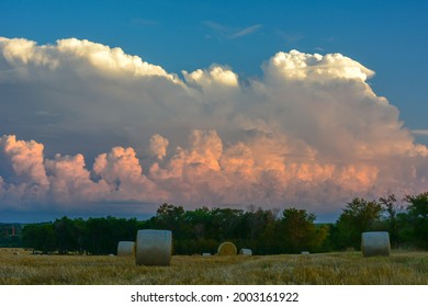 A field of straw bales with beautiful cloud formation looming above them in rural Minnesota, USA.  - Shutterstock ID 2003161922