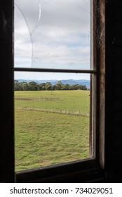 The field through the broken barn window