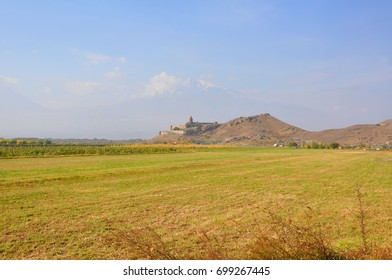 Field in the village of Lusarat. In the distance is the monastery of Khor Virap. Armenia