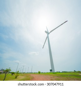 Field of white wind turbines generating electricity
