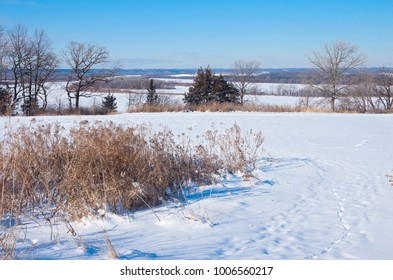 fields bluffs and river valley vista during winter at spring lake park reserve in hastings minnesota