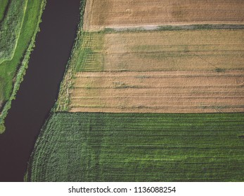 Fields by a river