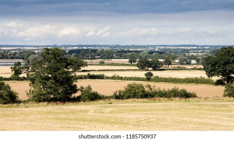 Fields of crops and pasture are interspersed with copice woodland in the patchwork agricultural landscape of England's Nene Valley in Northamptonshire.