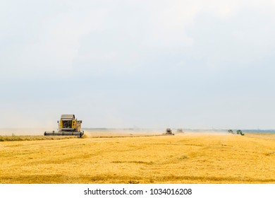 Fields near Krasnodar, Russia - July 15, 2017: Harvesting wheat with a combine harvester. Field of ripe wheat. Agricultural machinery.