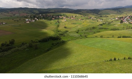 fields and small village in background