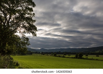 Fields under a moody sky in Perthshire