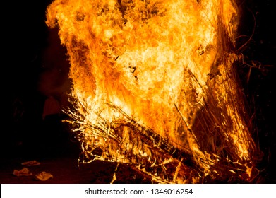 Fierce blaze of wooden bonfire on hindu festival of holi lohri on Holika Dahan. This spring harvest festival is celebrated by roasting grain, popcorn, sesame sees, chikki, peanuts and collecting coal