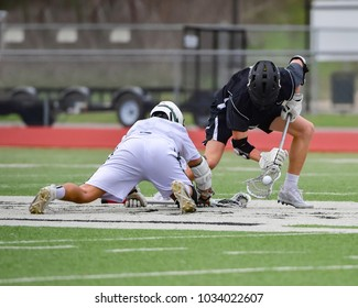 Fierce Lacrosse Action Between two teams in a Match