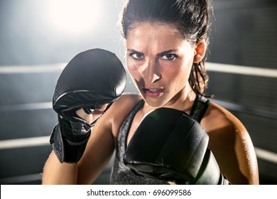 Fierce strong intense dramatic portrait of an angry and serious focused boxer fighter in a fight