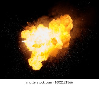 Fiery bomb explosion with sparks isolated on black background. Fiery detonation.