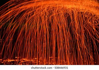 fiery embers falling in darkness background