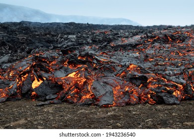 Fiery flowing lava. Volcano eruption at Fagradalsfjall, Iceland. Volcanic background.