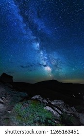 The fiery galaxy Milky way in the night sky with millions of stars over the White Elephant Observatory, which is in the Ukrainian Carpathian Mountains
