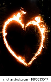 a fiery heart glows with a red flame at night. valentine's day and love symbol.