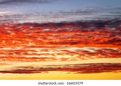 Fiery orange sunset sky. Beautiful sky. Sky Background