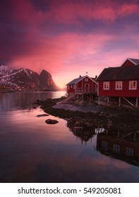 Fiery pink sunrise over Reine, Lofoten Islands, Norway