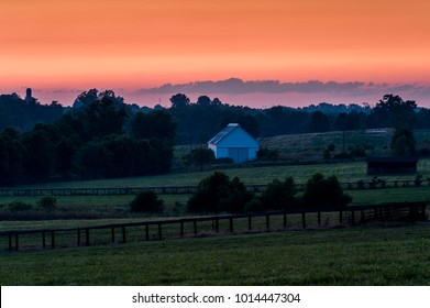 A fiery summer sunset as viewed from a famed horse farm in the Bluegrass region of central Kentucky.