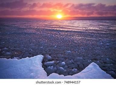 A fiery sunrise gives off warmth on a frigid northern Michigan morning near Traverse City
