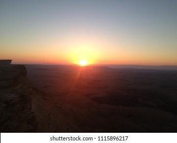 Fiery sunrise in Negev Desert near Mitzpe Ramon crater - Israel