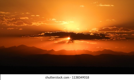 fiery sunset over the colorado rocky mountains, as seen from broomfield, colorado