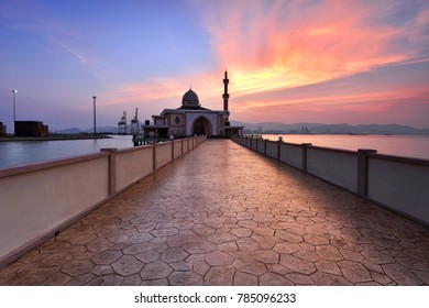 Fiery sunset over the mosque in Penang, Malaysia