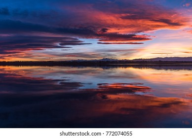Fiery sunset reflection over the reservoir