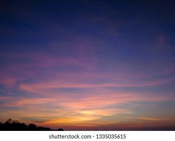 Fiery sunset sky with Cloud density. night sky .