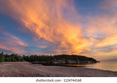 Fiery sunset sky over Lake Superior coastline