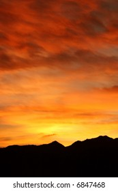 Fiery winter sunrise in the Colorado Rocky Mountains boasts brilliant shades of red, orange, and yellow.