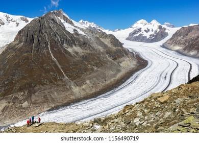 Fiesch, Swizterland: 25 September 2017 - Hikers viewing the Great Aletsch Glacier - largest European glacier and the UNESCO Nature heritage, Bernese Alps, Switzerland