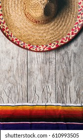 Fiesta: Mexican Sombrero With Serape Blanket On Weather Wood