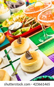 Fiesta party buffet table with dulce de lecheand other traditional Mexican food.